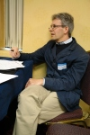 Christian Wannenmacher (Ludwig-Maximilians-Universität München), the keynote speaker, listens intently to a presentation.